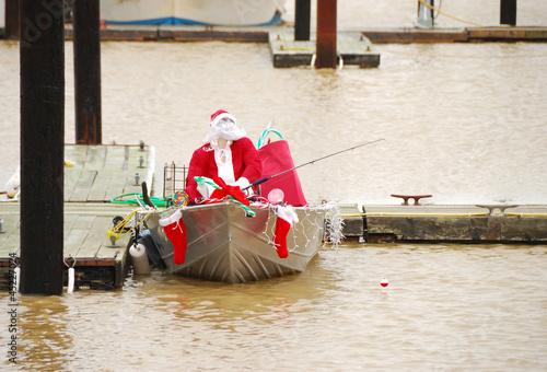 Leinwanddruck Bild Santa Claus Fishing in the Bay