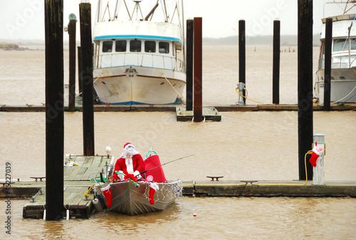 Leinwandbild Motiv Santa Claus Fishing in the Bay
