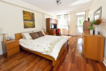 Bedroom interior with hardwood floor