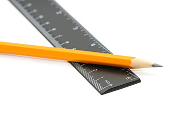 Pencils and ruler isolated on white background