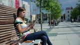 Young woman with tablet computer in the city, steadicam shot