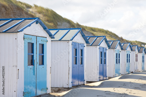 Dutch little houses on beach in De Koog Texel, The Netherlands
