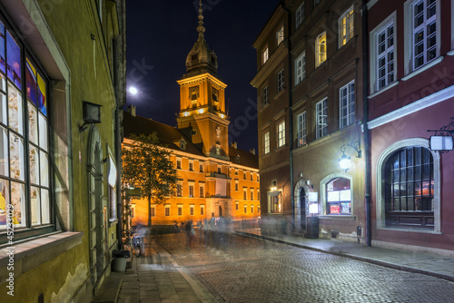 Old Town street at night with view to Royal Palace in Warsaw