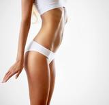 Fototapety Slim tanned woman's body.