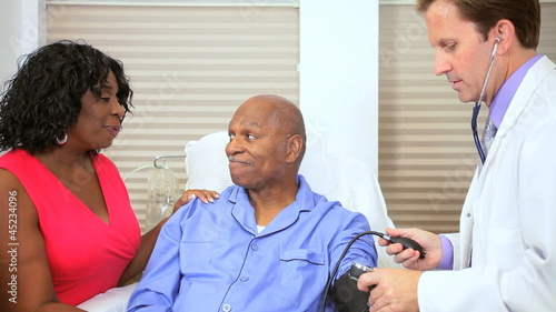 Hospital Doctor Checking Patient Blood Pressure