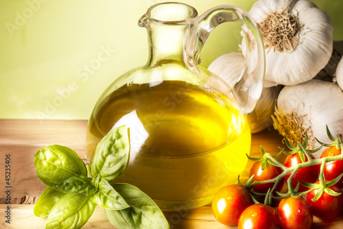 still life with olive oil,vegetables on wood table