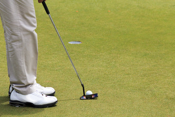 male golfer setup for his putting