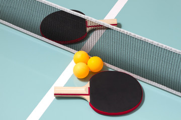Table tennis rackets and balls