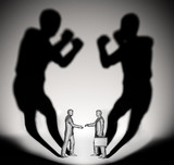 Fototapety Two businessman casting a shadow shaped like two fighters