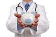 Doctor holding piggy bank