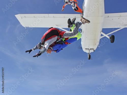 Foto Spatwand Luchtsport Saut en parachute en tandem (sortie d'avion)