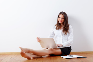 business woman working at home with laptop