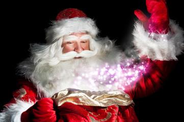 Santa Claus at home at night making magic