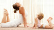 Mother and daughter doind exercise
