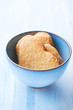 Butter cookies with sugar in a ceramic bowl