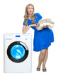 The happy young woman near the new washing machine..