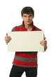 Young sexy man holding a copy space blank sign isolated on white
