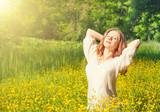 beautiful young woman enjoying the summer sun