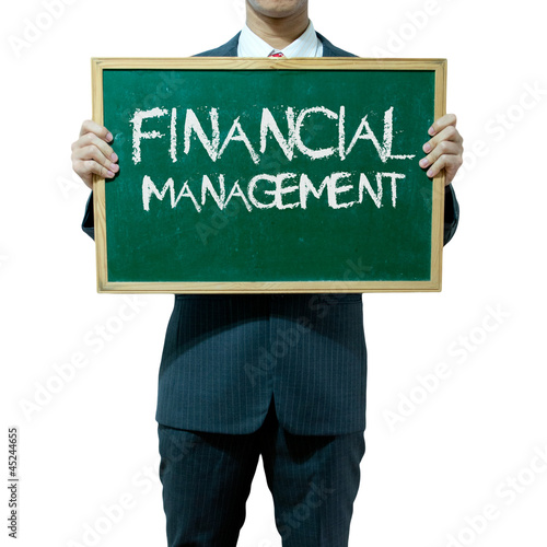 Business man holding blackboard on the background , Financial