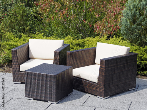 outdoor furniture rattan armchairs and table