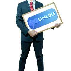 Business man holding board on the background with symbol
