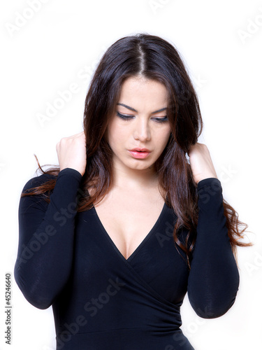 Studio shot of young beautiful woman on white background.
