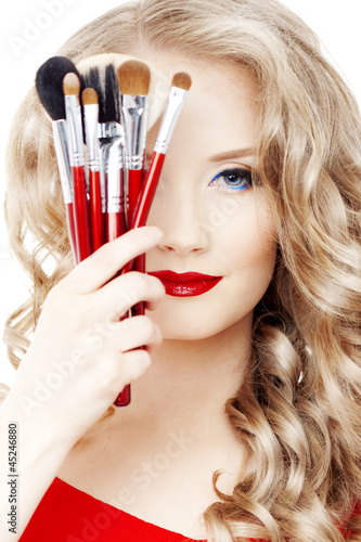 Stylist with make up brushes