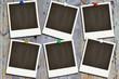 Polaroids an einer Holzwand
