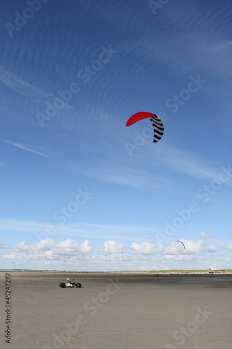 kite buggy parakarting with cirrus clouds and blue sky