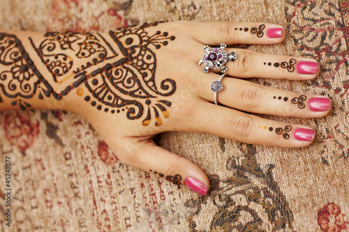 Henna art on woman's hand