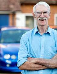 Senior man with car