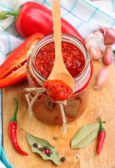 Red pepper sauce in a jar