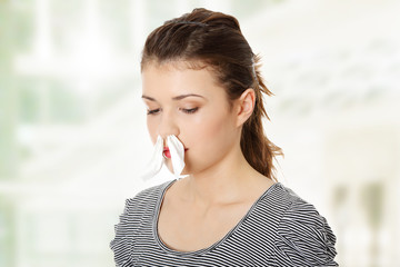 Woman with tissue in her nose