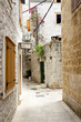 View on narrow alley - Trogir, Croatia.