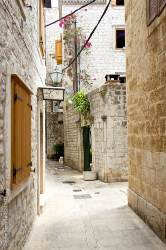 Wall mural View on narrow alley - Trogir, Croatia.