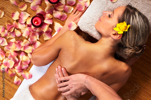 Young woman in Spa massage salon.