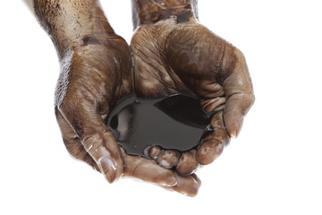 Hands with black oil