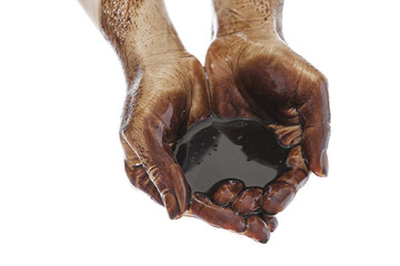 Hands cupped with black heavy fuel isolated on white background