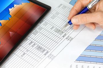 Tablet Computer with Hand Pen Figures Blue Orange Graphs