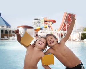 two happy children having fun in aqua water park