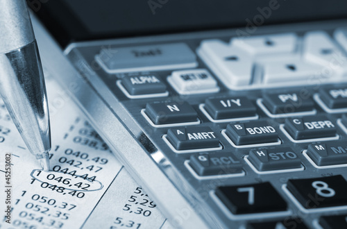 Calculator and a financial document.
