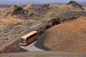 Touristic bus making a trip in the Timanfaya desert, Lanzarote