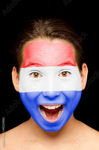 girl with Netherlands flag painted on her face
