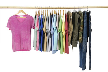 different colors shirt with trousers on wooden hangers