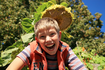 Happiness boy under sunflower.