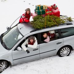 Christmas - family in car with gifts &christmas tree
