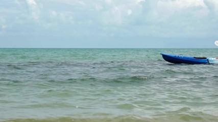 Woman kayaking at tropical sea