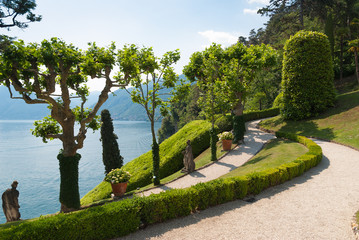Tranquil winding path along the shore of lake Como