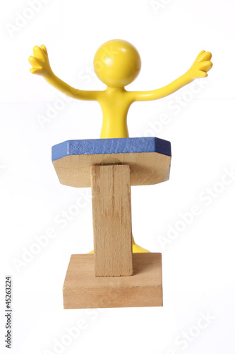 Miniature Figure on Rostrum