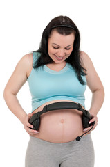 Pregnant belly with headphones